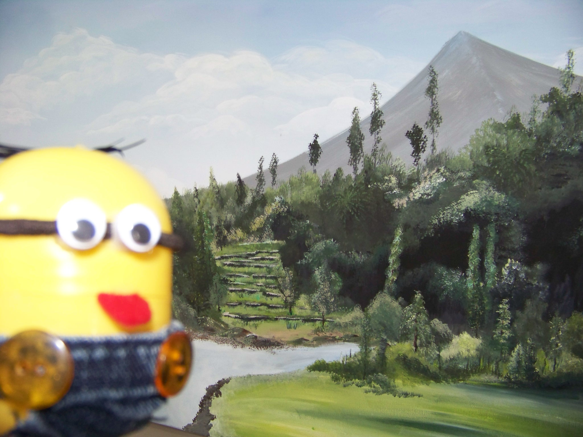 minion beside painting